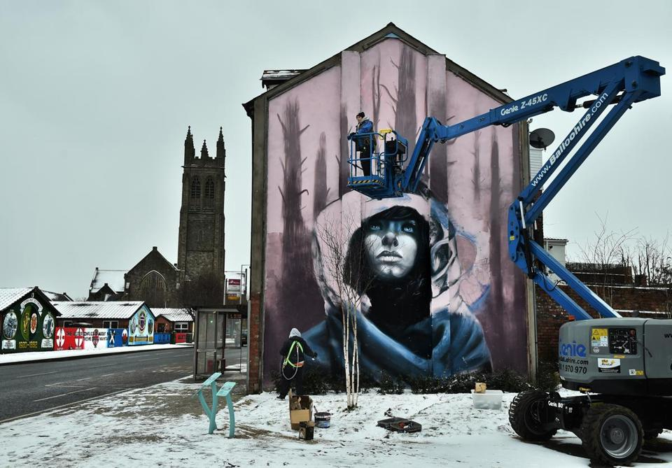 The street art duo Nomad Clan worked on a mural in Belfast on March 1.