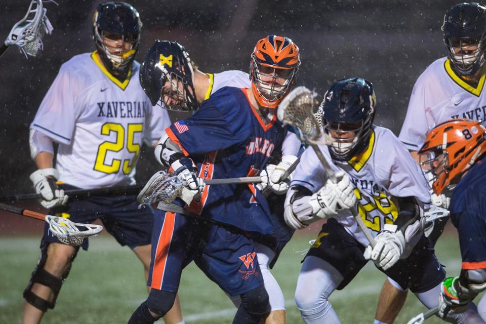 Walpole High School senior Darragh Fahey is surrounded by Xavarian players during their lacross game in Westwood Tuesday, April 3, 2018. Gretchen Ertl for The Boston Globe.