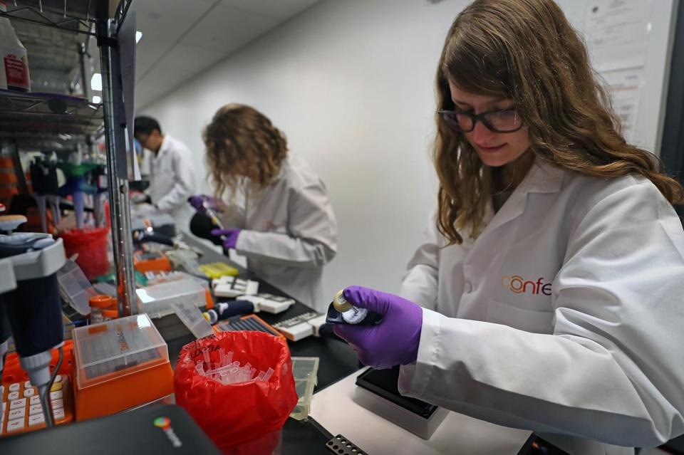 Scientist Jess Miller (right) at work in the lab at Confer Health in Charlestown.