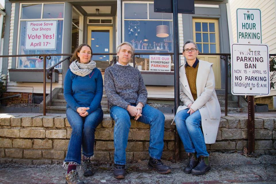 WISCASSET, ME - APRIL 5: Wiscasset business owners Stacy Linehan of Treats Bakery, James Kochan of James Kochan Fine Art and Antiques and Erika Soule of Rock Paper Scissors sit outside Soule's shop on Thursday, April 5, 2018 . The Maine Department of Transportation's plan to eliminate on-street parking in the town, in order to widen the travel lanes and reduce bottlenecks during the summer tourist season, is being met by opposition by the three owners. (Carl D. Walsh for The Boston Globe)