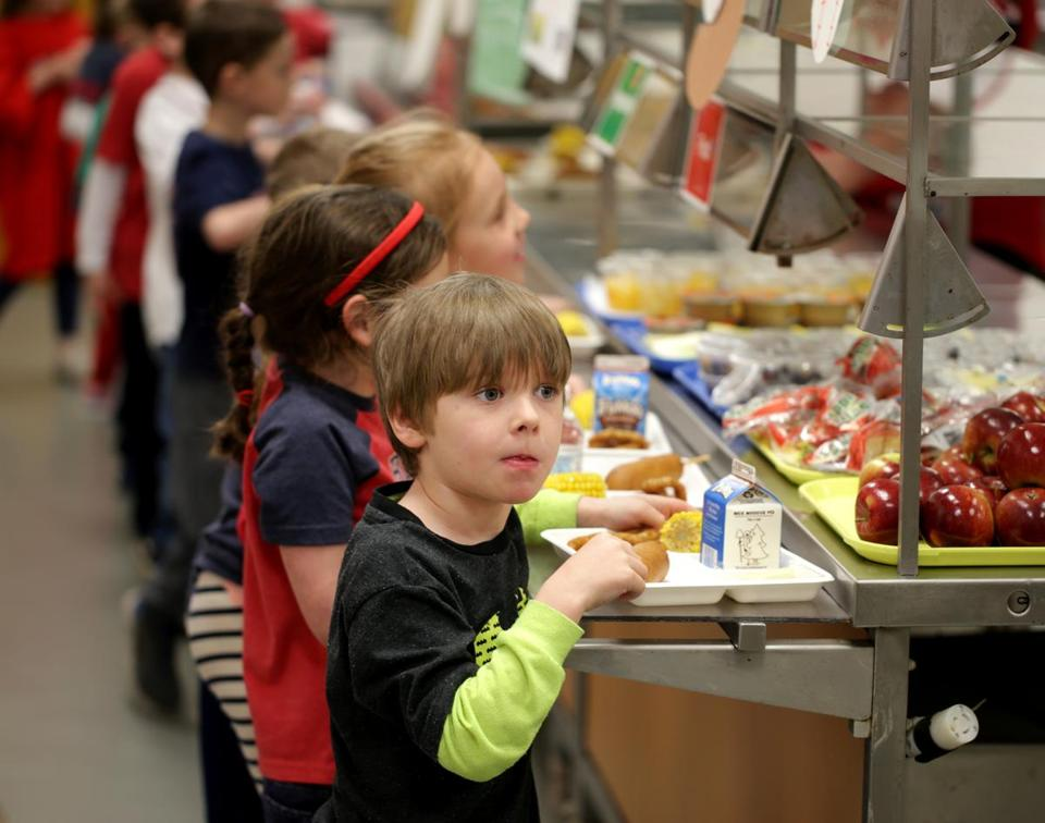 04/05/2018 Hingham Ma -Luke Bigham (cq) goes through lunch at Plymouth River Elementary School. Jonathan Wiggs /Globe Staff Reporter:Topic.