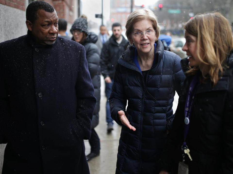 From left: Suffolk County Sheriff Steven W. Tompkins with Senator Elizabeth Warren and Dr. Jessie Gaeta in the South End.