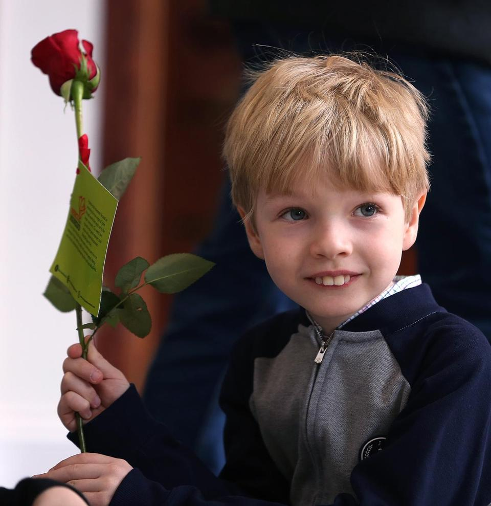 Kasim Kulovic, 8, of Arlington, handed out roses to visitors. He's been attending the mosque for about five years.