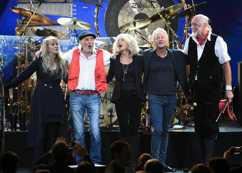 Guitarist Lindsey Buckingham (second from right) is parting ways with Fleetwood Mac.