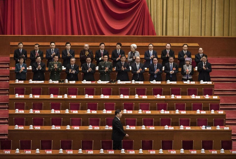 BEIJING, CHINA - MARCH 20: China's President Xi Jinping, bottom, is applauded as he arrives to the closing session of the National People's Congress at The Great Hall Of The People on March 20, 2018 in Beijing, China.