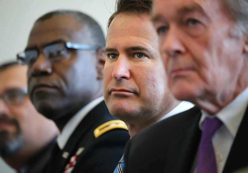 Representative Seth Moulton of Massachusetts, center, during a news conference in Burlington in April.