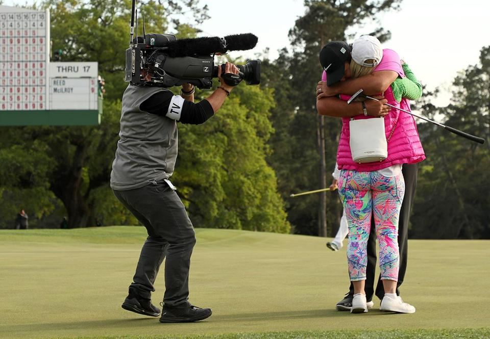 AUGUSTA, GA - APRIL 08: Patrick Reed of the United States celebrates with his wife Justine after making par 18th green during the final round to win the 2018 Masters Tournament at Augusta National Golf Club on April 8, 2018 in Augusta, Georgia. (Photo by Jamie Squire/Getty Images)