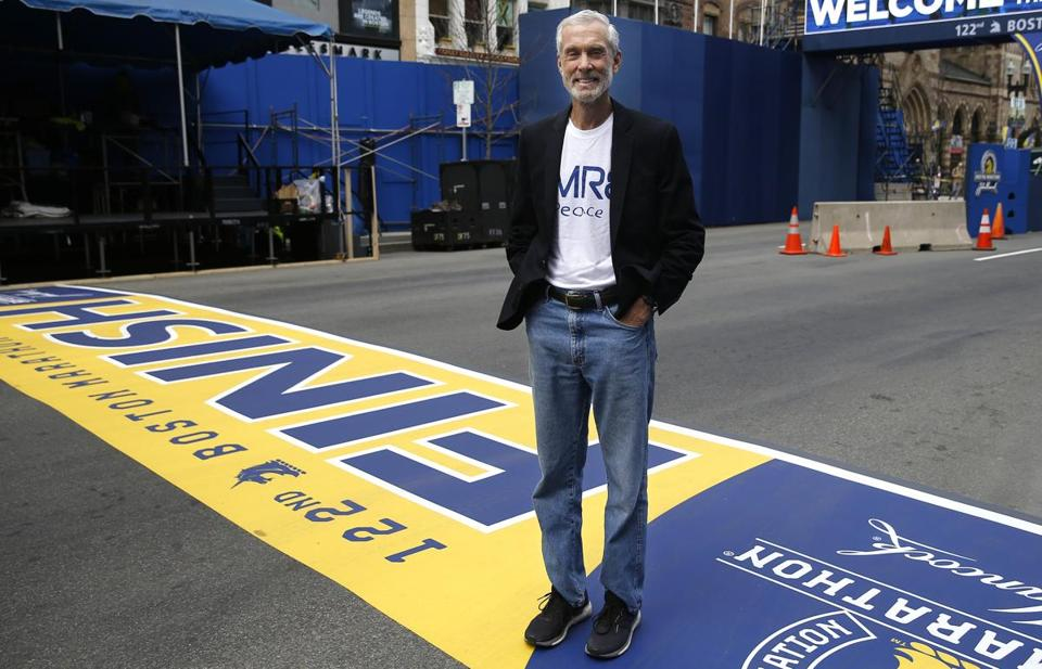 Amby Burfoot poses for a portrait at the Boston Marathon finish line.