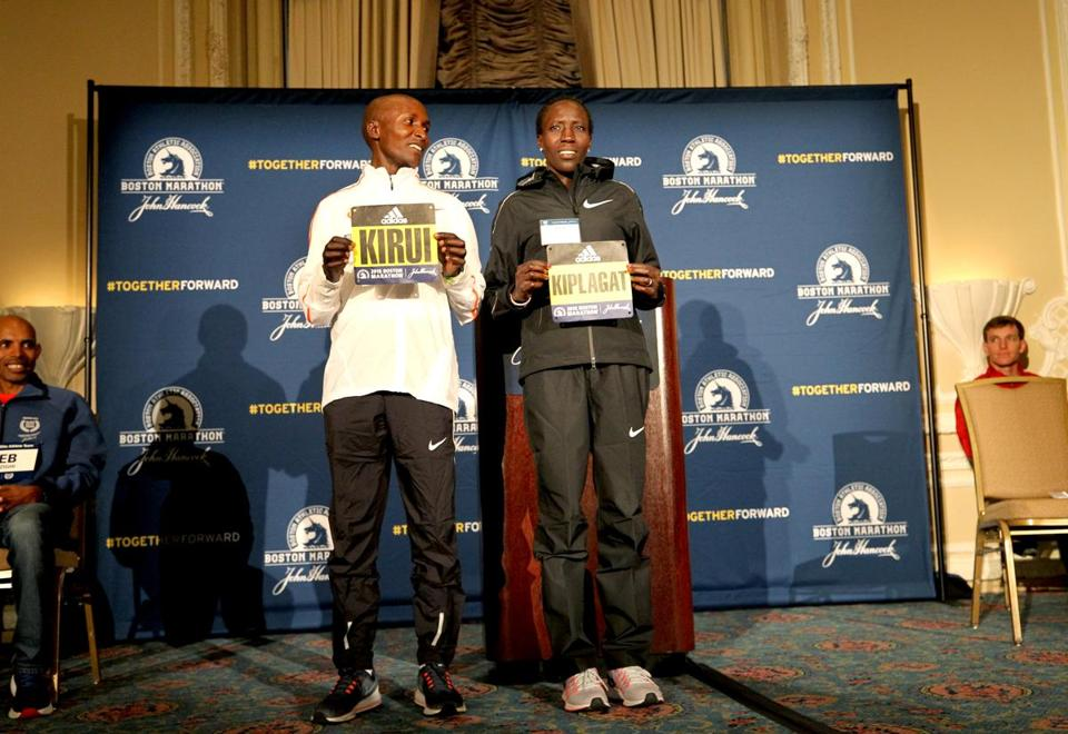 Boston, MA., 041318, Elite marathoners Geoffrey Kirui, left, and Edna Kiplagat at the press conference. The elite Boston Marathon runners gather for press availability at the Fairmont Copley Plaza Hotel. Suzanne Kreiter/Globe staff