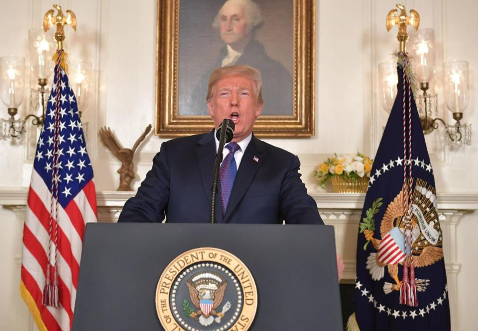 TOPSHOT - US President Donald Trump addresses the nation on the situation in Syria April 13, 2018 at the White House in Washington, DC. Trump said strikes on Syria are under way. / AFP PHOTO / Mandel NGANMANDEL NGAN/AFP/Getty Images