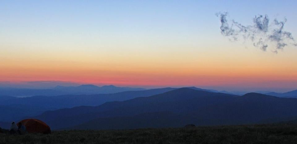 Campers had a prime view for the rise of the sun and the fall of the full moon atop the ridge near Round Bald.