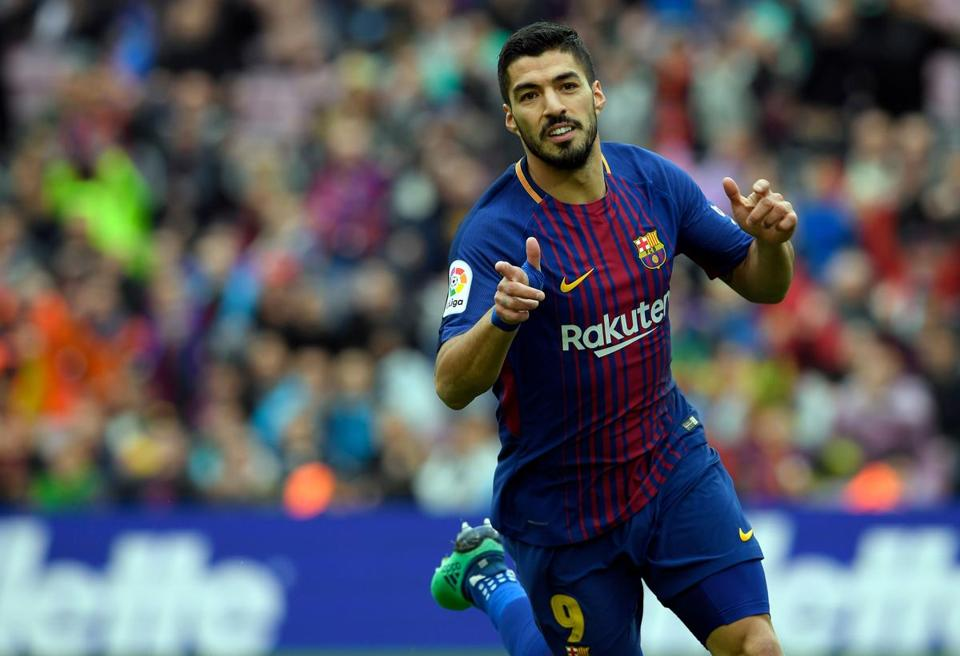 Barcelona's Uruguayan forward Luis Suarez celebrates a goal during the Spanish league footbal match between FC Barcelona and Valencia CF at the Camp Nou stadium in Barcelona on April 14, 2018. / AFP PHOTO / LLUIS GENELLUIS GENE/AFP/Getty Images