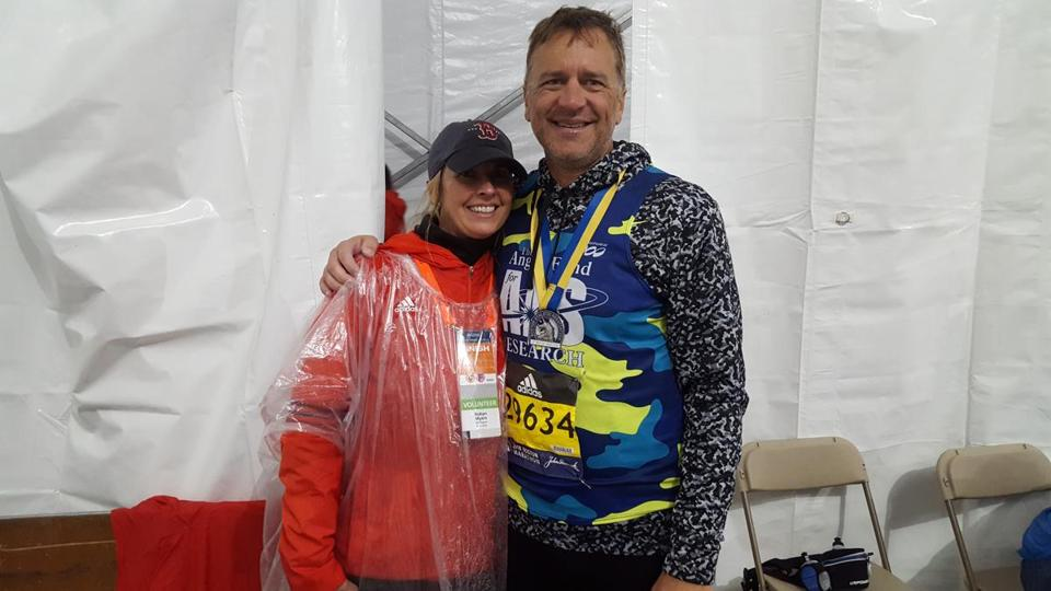Former Red Sox pitcher Mike Myers, with his wife Robyn, was all smiles after finishing the Boston Marathon.