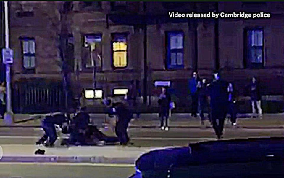 "Cambridge's mayor called a video of a police officer repeatedly striking a black Harvard University student while he was pinned to the ground by fellow officers ""disturbing"" and promised that the findings of an internal probe would be made public."