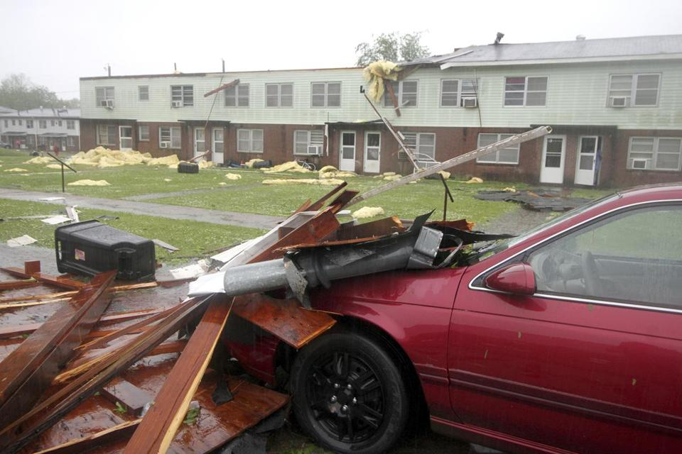 A parked car in Meridian, Miss., was covered with debris Saturday after a suspected tornado moved through the area.