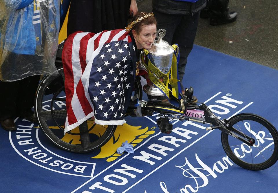 Boston, MA--4/16/2018-- Women's wheelchair race winner Tatyana Mcfadden receives her trophy at the finish line of the 122nd Boston Marathon. (Jessica Rinaldi/Globe Staff) Topic: Reporter: