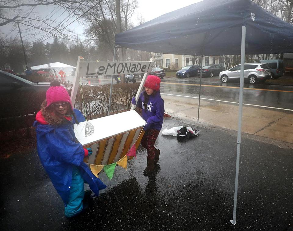 It was a tough day for Hopkinton lemonade vendors Payton Richard (left) and Lila Harber, who switched to hot chocolate before calling it a day.