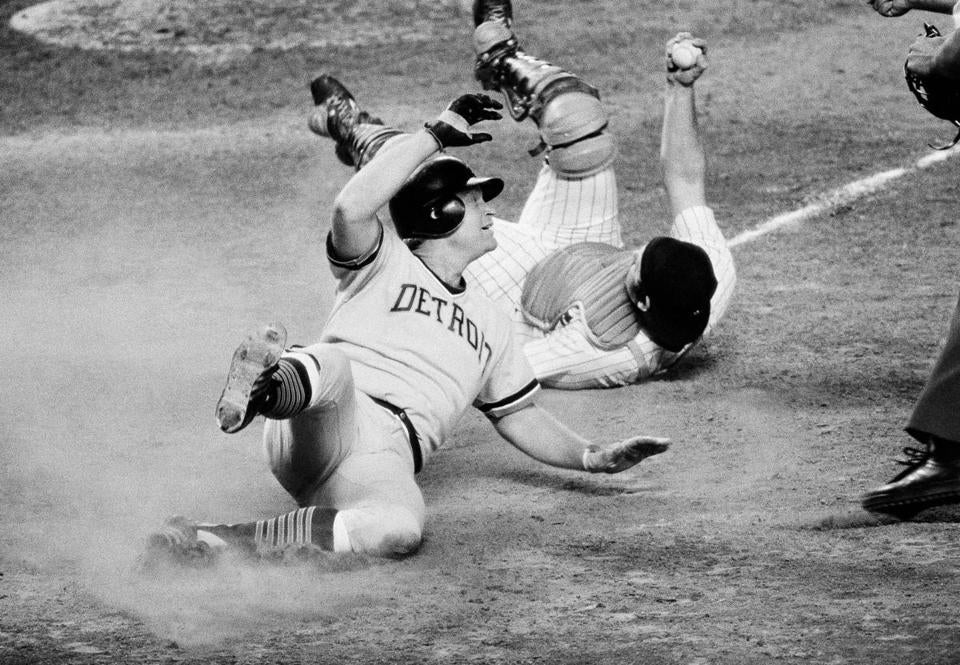 Rusty Staub, in his days with the Tigers, slides into home in a 1978 games against the Yankees.