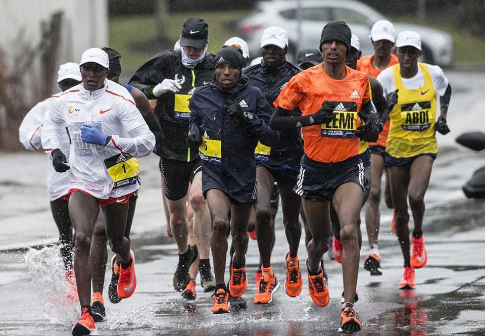 Natick, MA - 4/16/2018 - elite men's runners run through the rain along the route of the Boston Marathon in Natick, MA, Apr. 16, 2018. (Keith Bedford/Globe Staff)