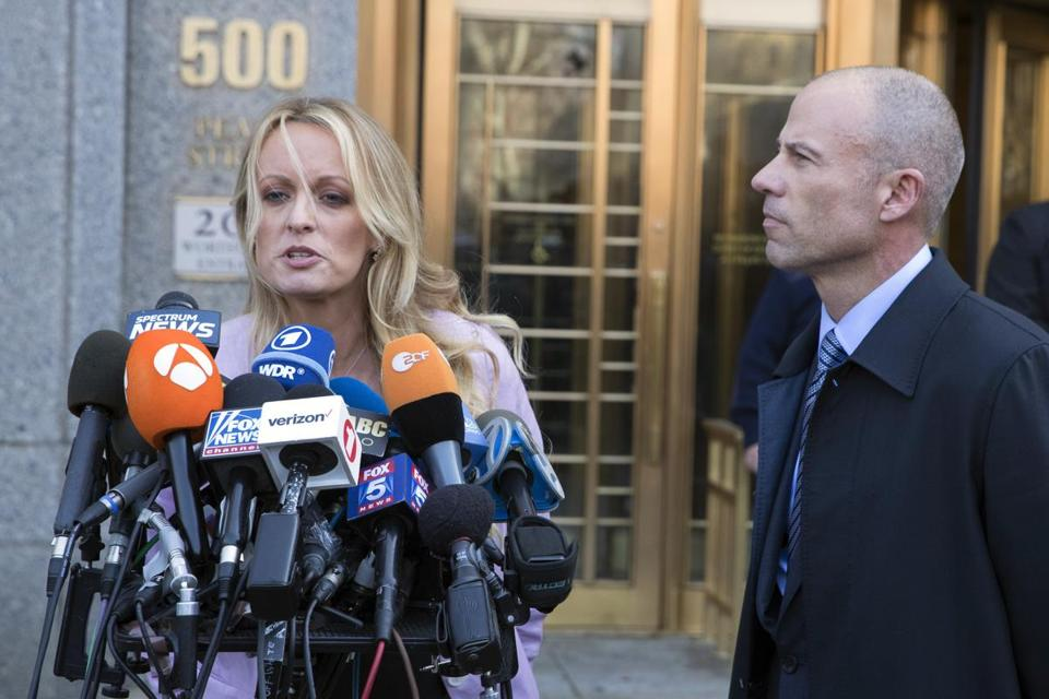 Adult film actress Stormy Daniels (left) spoke alongside her lawyer, Michael Avenatti, outside federal court earlier this week.