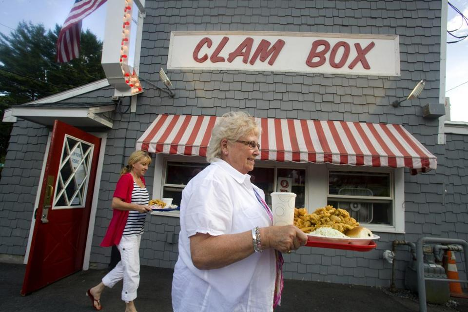 METRO- MaryBeth Walters of Cooperburg, PA, carries her fried clam dinner outside of the Clam Box in Ipswich, on Thursday July 27, 2012. Photographed for the Roads of Summer Series. (Laurie Swope)