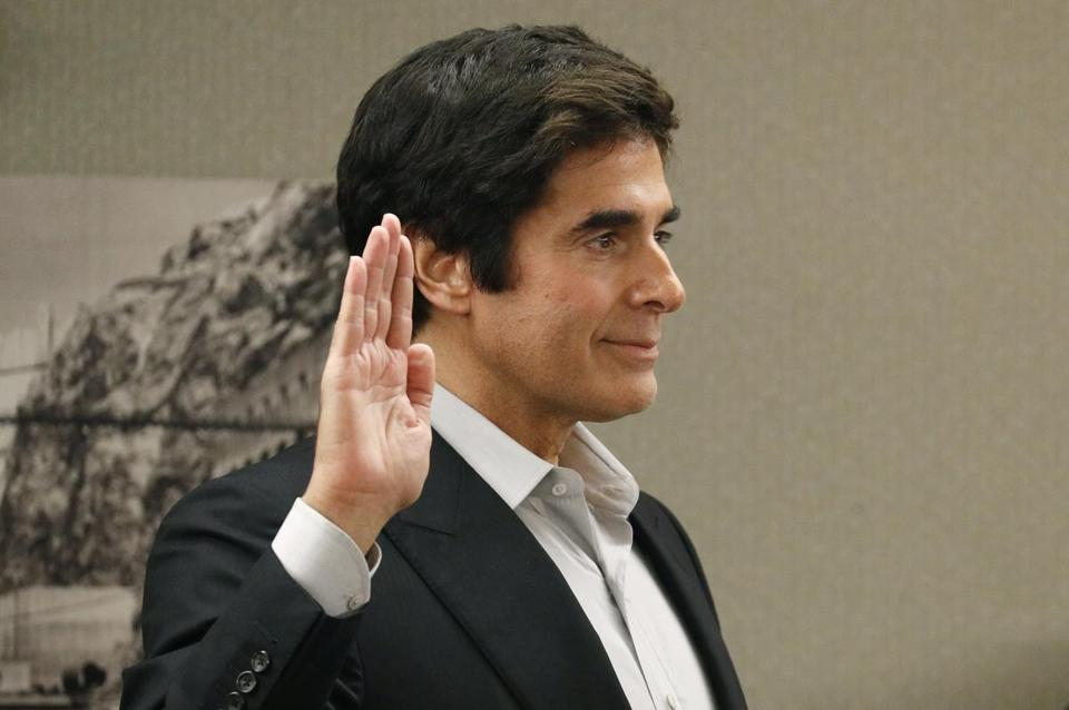 Illusionist David Copperfield is sworn in during court Wednesday, April 18, 2018, in Las Vegas. Copperfield testified in a negligence lawsuit involving a British man who claims he was badly hurt when he fell while participating in a 2013 Las Vegas show. (AP Photo/John Locher)
