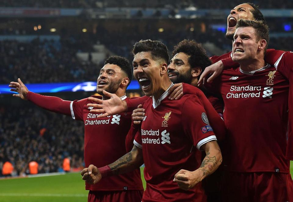 TOPSHOT - Liverpool's Brazilian midfielder Roberto Firmino celebrates scoring his team's second goal during the UEFA Champions League second leg quarter-final football match between Manchester City and Liverpool, at the Etihad Stadium in Manchester, north west England on April 10, 2018. / AFP PHOTO / PAUL ELLISPAUL ELLIS/AFP/Getty Images