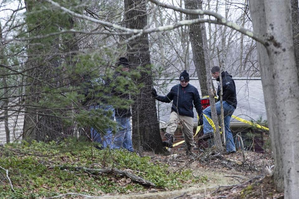 In West Brookfield, investigators probed the scene where a mother and three children were found murdered in their home last month.