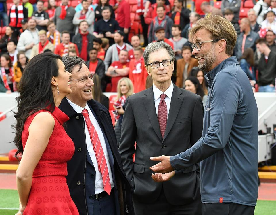 John Henry (right, center), with wife Linda Pizzuti Henry, Liverpool chairman Tom Werner, and team manager Jurgen Klopp, owns Liverpool FC.