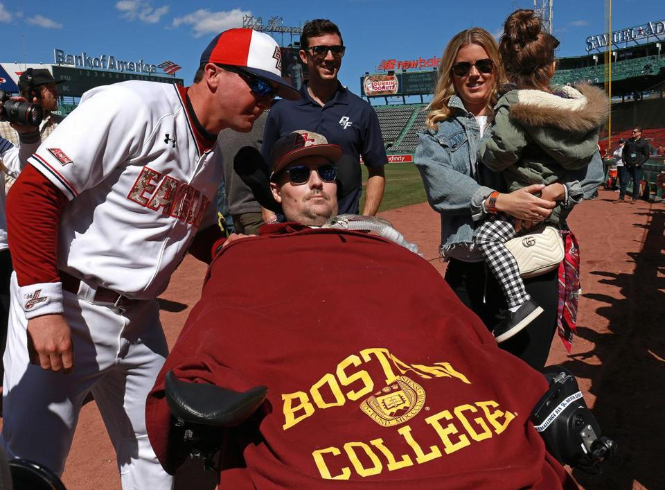 8Boston, MA - 4/21/2018 - Boston College head baseball coach Mike Gambino with Pete Frates, brother Andrew, and Pete's wife Julie and daughter Lucy. SJ Prep and BC grad Pete Frates at pre game ceremony before the start of the 7th Annual ALS Awareness game between Boston College and 17th-ranked Florida State at Fenway park . - (Barry Chin/Globe Staff), Section: Sports, Reporter: Matthew Doherty, Topic: 22schrdp, LOID: 8.4.1689018287.