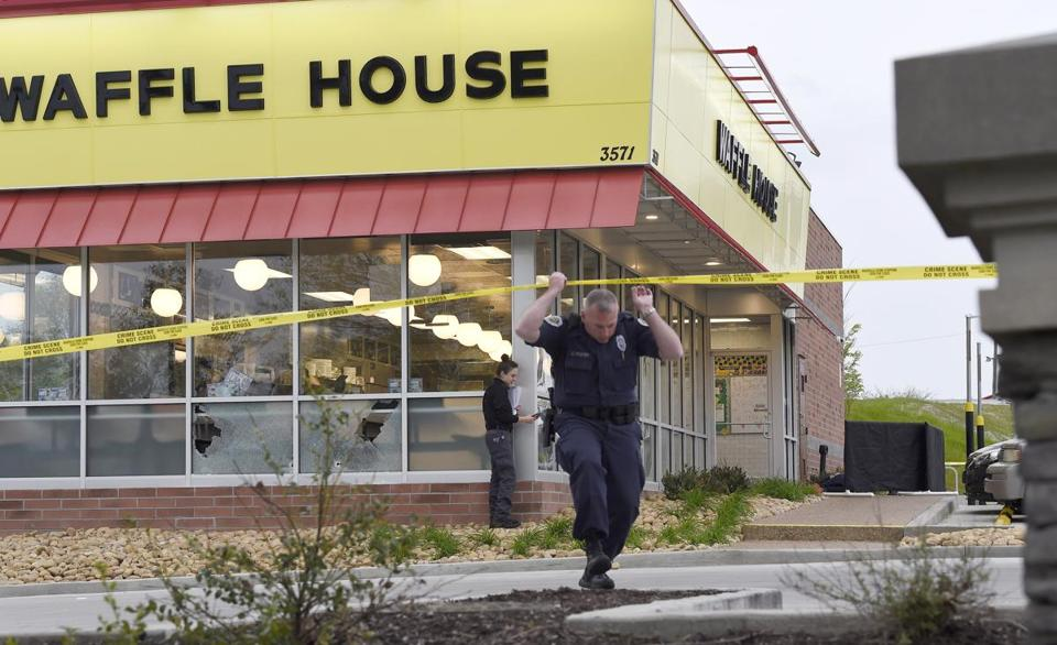 Law Enforcement Officials Work The Scene Of A Fatal Shooting At A Waffle  House In The