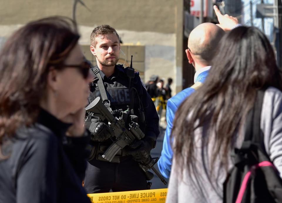 A Toronto police officer stood guard at the police line.