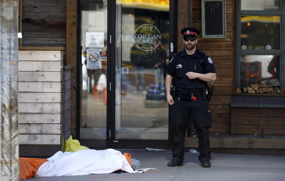 A tarp covered an unidentified body on Yonge St. at Finch Ave.
