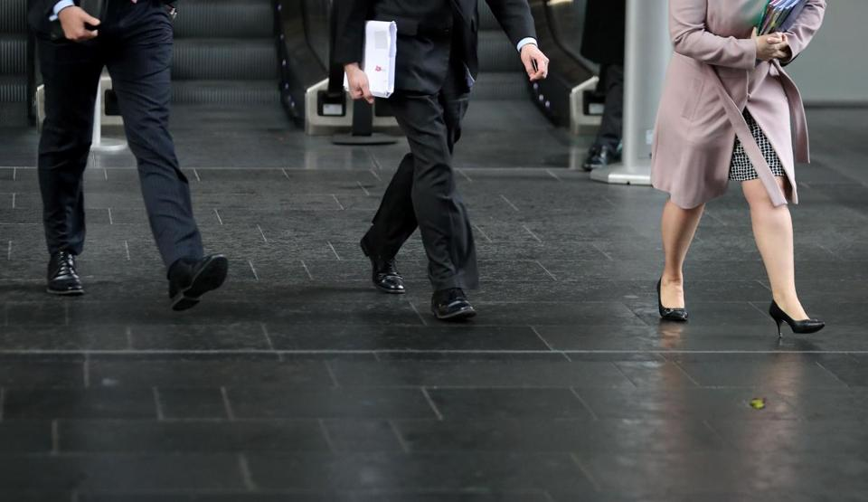 Business men and women walk in the City of London on April 4, 2018. Employers with more than 250 staff have until midnight on Wednesday to publish the gender pay gap within their companies. Britain's Prime Minister Theresa May is eager to see a change in the gender gap, or percentage difference between the average male salary and the average female salary -- in an eventual push toward pay equality, meaning the same money for a comparable job. / AFP PHOTO / Daniel LEAL-OLIVASDANIEL LEAL-OLIVAS/AFP/Getty Images