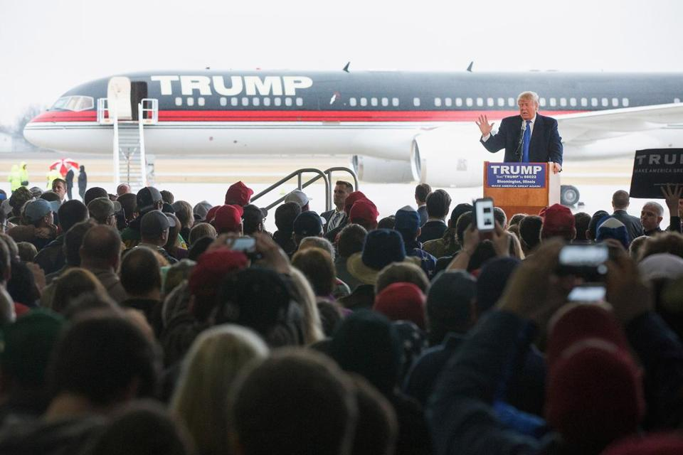 BLOOMINGTON, IL - MARCH 13: Republican presidential candidate Donald Trump speaks to guests gathered for a rally at the Central Illinois Regional Airport on March 13, 2016 in Bloomington, Illinois. The Trump campaign cancelled a recent rally in Chicago after learning hundreds of demonstrators were ticketed for the event. Illinois voters go to the polls on March 15. (Photo by Scott Olson/Getty Images)