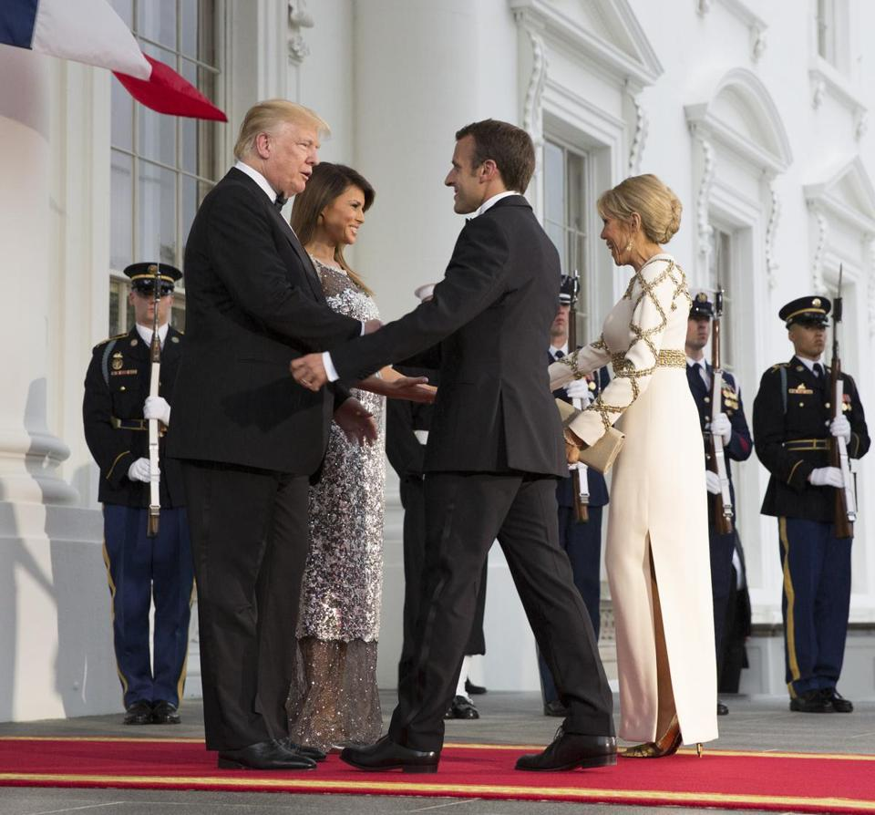 WASHINGTON, DC - APRIL 24: U.S President Donald Trump and U.S. first lady Melania Trump greet French President Emmanuel Macron and French first lady Brigitte Macron after their arrival at the North Portico before a State Dinner at the White House, April 24, 2018 in Washington, DC. Trump is hosting Macron for a two-day official visit that included dinner at George Washington's Mount Vernon, a tree planting on the White House South Lawn and a joint news conference. (Photo by Chris Kleponis-Pool/Getty Images)