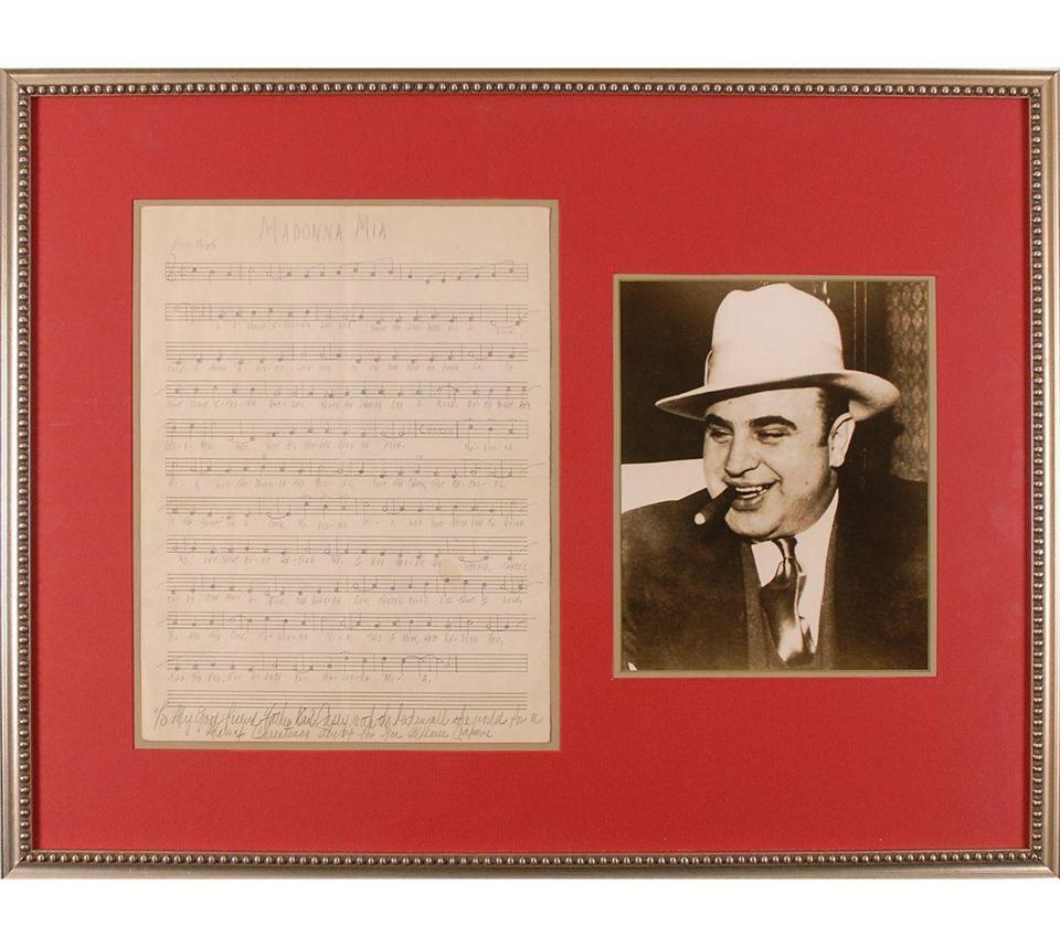 "xxcapone -- It was once thought that Al Capone wrote the song ""Madonna Mia"" for his wife, Mae, while he was doing time at Alcatraz. But in reality, he most likely copied the music and lyrics from a songbook. (RR Auction)"