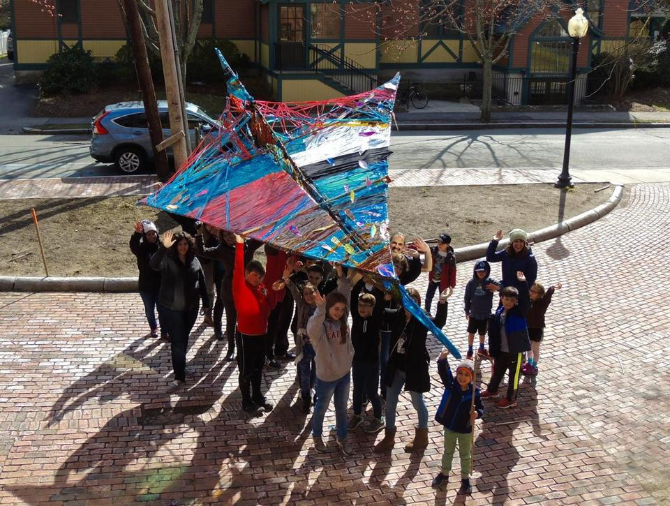 Fitchburg students showed off an 18-foot-long prototype of the record-breaking paper airplane. The full-size version is planned to be 64 feet long.