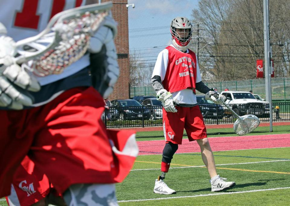 (West Roxbury, MA 04/28/18) Catholic Memorial lacrosse goalie Matt Freitas walks onto the field before his team's matchup against Needham at Catholic Memorial. (Photo by John Wilcox, for the Globe)
