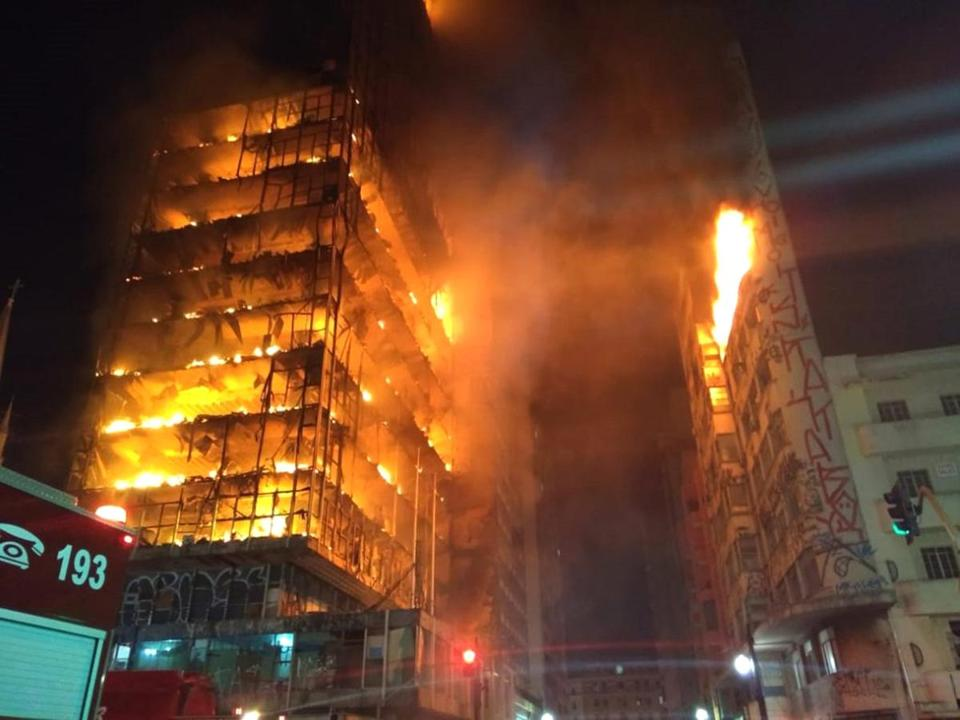 In this photo released by Sao Paulo Fire Department, a building on fire is seen in Sao Paulo, Brazil, Tuesday, May 1, 2018. A burning building in downtown Sao Paulo has collapsed as firefighters worked to put out a fire that began in the middle of the night. (Sao Paulo Fire Department via AP)