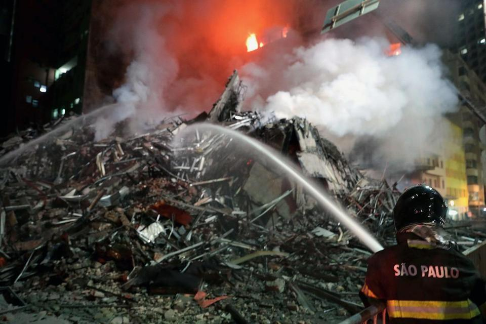 Brazilian firemen operated on the site where a 26-storey building collapsed after a fire.