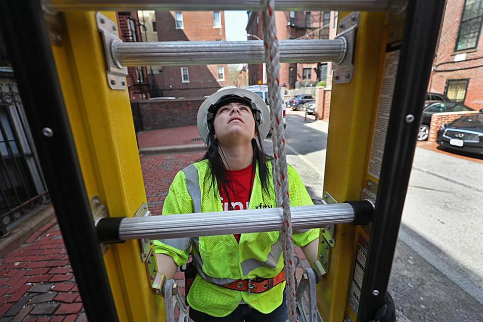 Lauren Bonsignore at work in Boston as a Comcast technician.