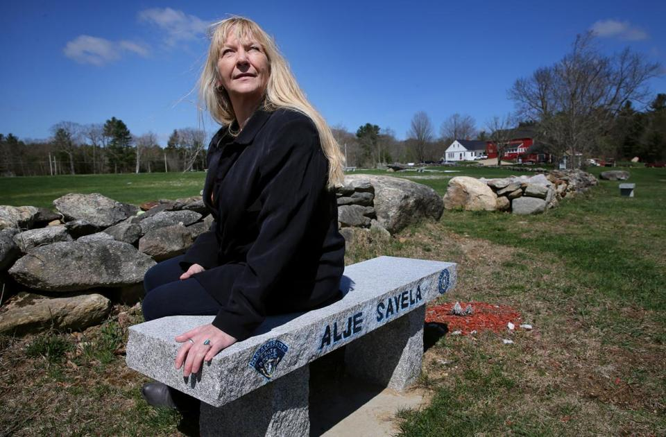 Amy Grandone rested on a bench that her grandfather, John P. Harty Sr., dedicated to State Trooper Alje Savela in Barre.