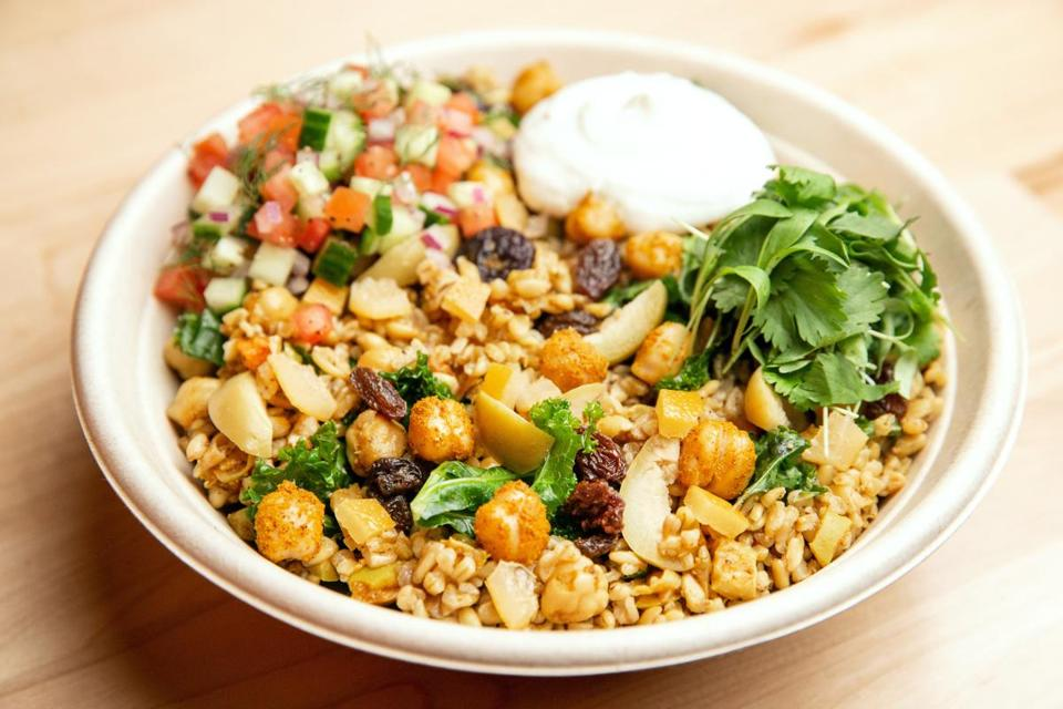 The Moroccan bowl includes chickpeas, tomatoes, currants, olives, preserved lemon, cilantro.