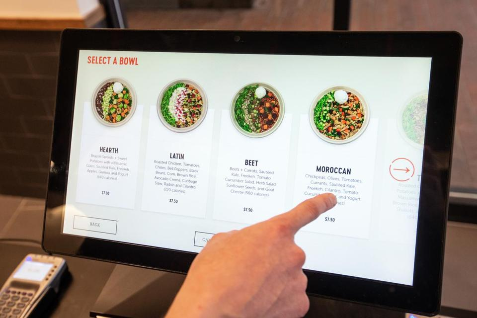 A customer swiped through the menu on an ordering kiosk at Spyce.