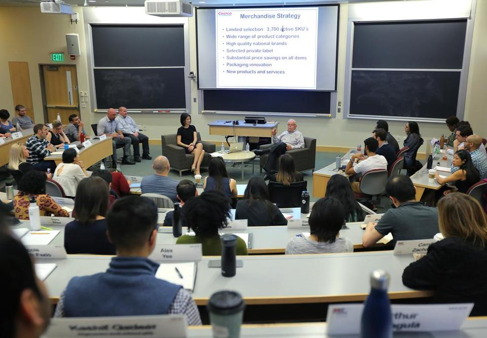 James Sinegal, center right, cofounder and retired CEO of Costco Wholesale, speaks to a class at the MIT Sloan School of Management. At left is Professor Zeynep Ton.