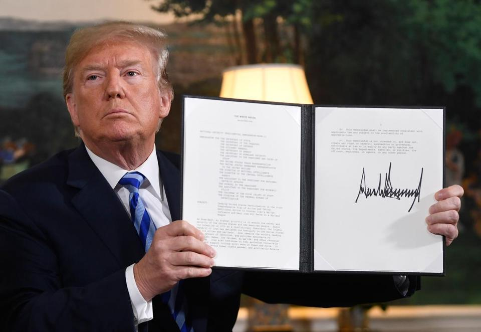 President Trump signed a document reinstating sanctions against Iran after announcing the US withdrawal from the Iran nuclear deal on Tuesday.