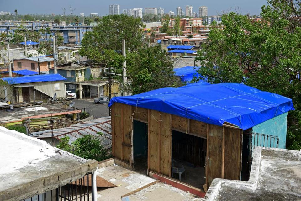 Homes stand covered with FEMA tarps in the Cantera neighborhood in San Juan, Puerto Rico.