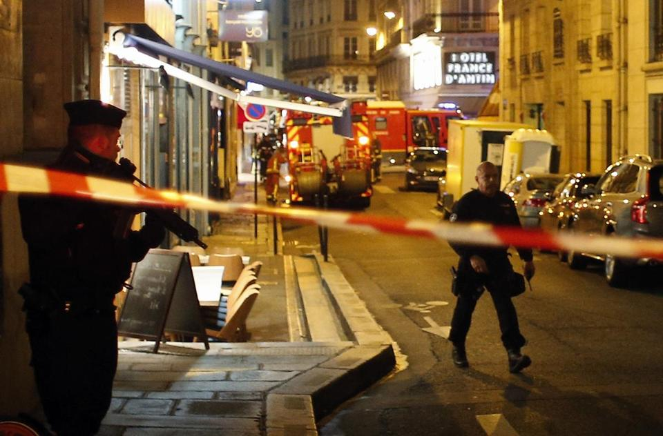 Police officers cordon off the area after a knife attack in central Paris on Saturday.