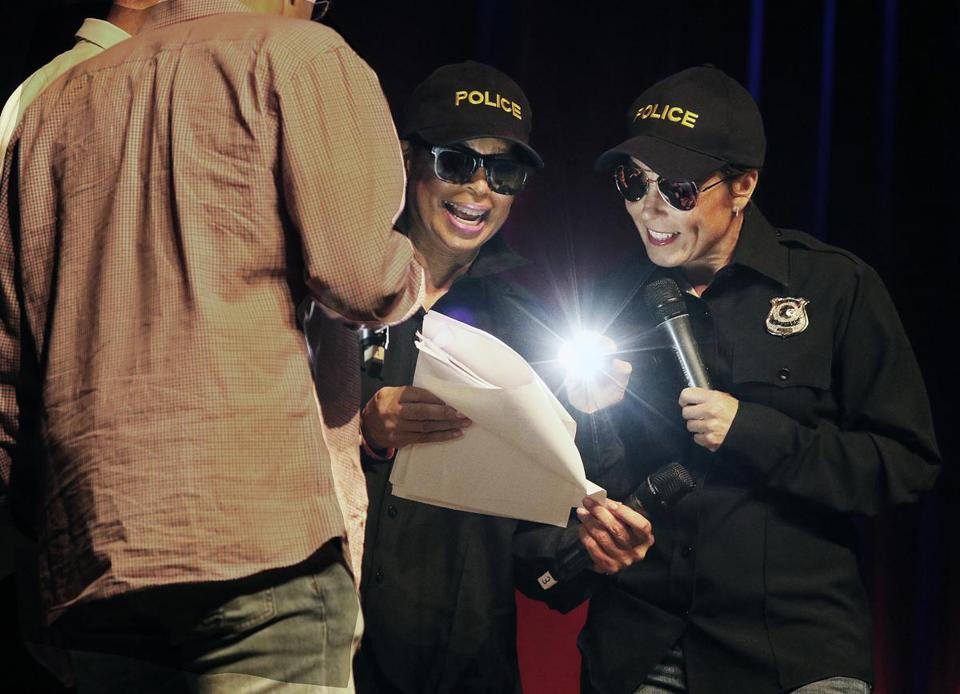 Carol Fulp (left), CEO of The Partnership, and Attorney General Maura Healey played police officers in a skit.
